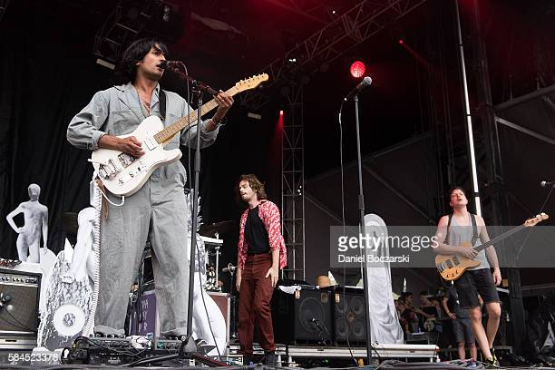 Anand Wilder Chris Keating and Ira Wolf Tuton of Yeasayer perform during Lollapalooza at Grant Park on July 28 2016 in Chicago Illinois