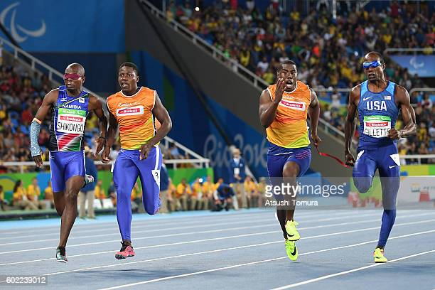 Ananias Shikongo of Nambia and Lex Gillette of the USA compete in the men's 100m T11 semi final on day 3 of the Rio 2016 Paralympic Games at Olympic...