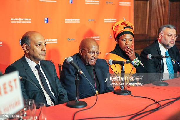 Anant Singh Archbishop Desmond Tutu Reverend Mpho Andrea Tutu and Ebrahim Rasool speak at a panel at 2014 Shared Interest Awards gala on February 27...