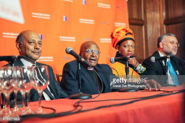 Anant Singh Archbishop Desmond Tutu Reverend Mpho Andrea Tutu and Ebrahim Rasool speak ata panel at 2014 Shared Interest Awards gala on February 27...