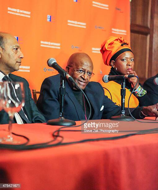 Anant Singh Archbishop Desmond Tutu Reverend Mpho Andrea Tutu speak at a panel at 2014 Shared Interest Awards gala on February 27 2014 in New York...