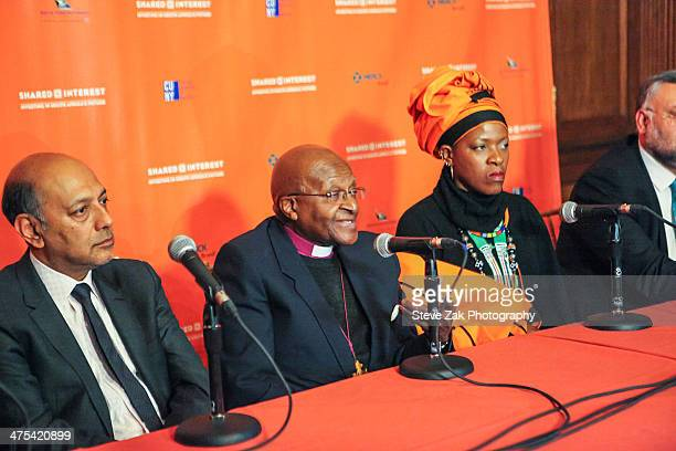 Anant Singh Desmond Tutu Mpho Andrea Tutu Ebrahim Rasool speak at a panel at 2014 Shared Interest Awards gala on February 27 2014 in New York City