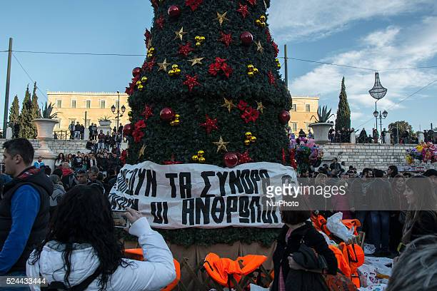 Anarchist from Athens throw buoys from refugees at the christmass tree on Syntagma square Greece Athens 27 December 2015