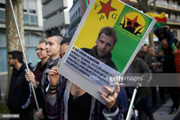 Anarchists brandish a placard depicting an Icelandic anarchist killed by Turkish army in Afrin' Kurds demonstrate to pay tribute to French fighter...