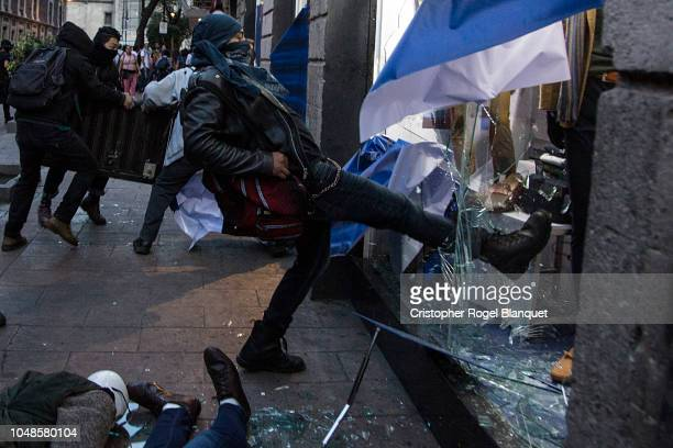 Anarchists perform acts of vandalism during a protest as part of the commemoration of the 50 anniversary of the massacre of students in Tlatelolco on...