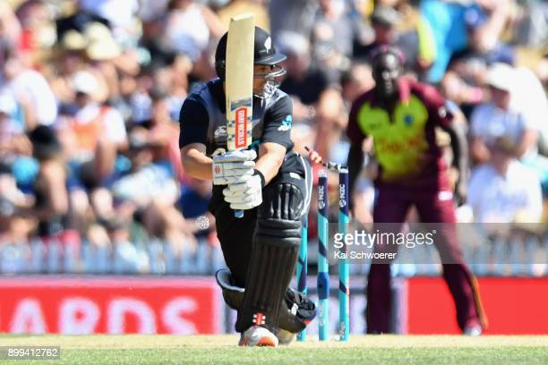 Anaru Kitchen of New Zealand is bowled by Kesrick Williams of the West Indies during game one of the Twenty20 series between New Zealand and the West...