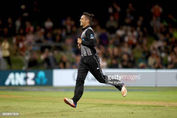 Anaru Kitchen of the New Zealand Black Caps celebrates his wicket of Rovman Powell of the West Indies during game three of the Twenty20 series...