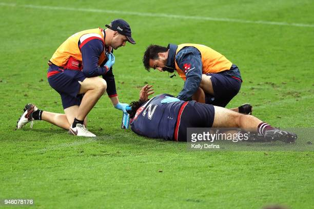 Anaru Rangi of the Rebels receives medical attention after a collision during the round nine Super Rugby match between the Rebels and the Jaguares at...