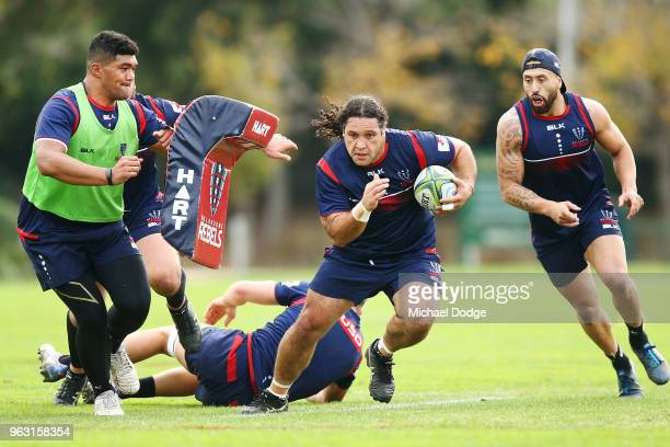 Anaru Rangi of the Rebels runs with the ball during a Melbourne Rebels Super Rugby training session at Gosch's Paddock on May 28 2018 in Melbourne...