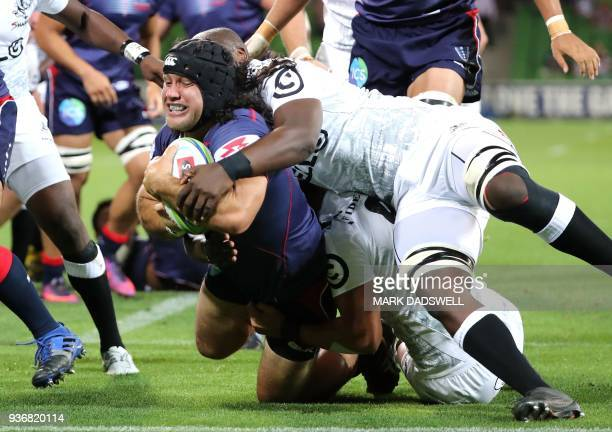 Anaru Rangi of the Rebels scores a try during the Super Rugby union match between the Melbourne Rebels of Australia and the Coastal Sharks of South...