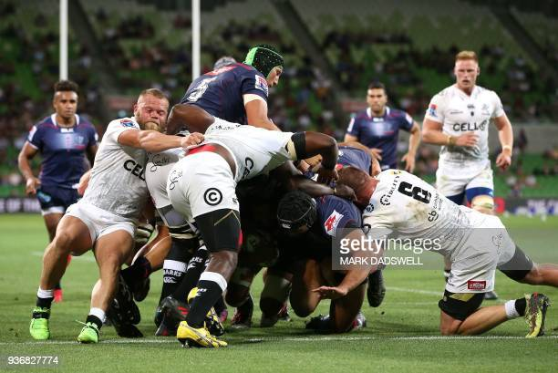 Anaru Rangi of the Rebels scores his second try during the Super Rugby union match between the Melbourne Rebels of Australia and the Coastal Sharks...