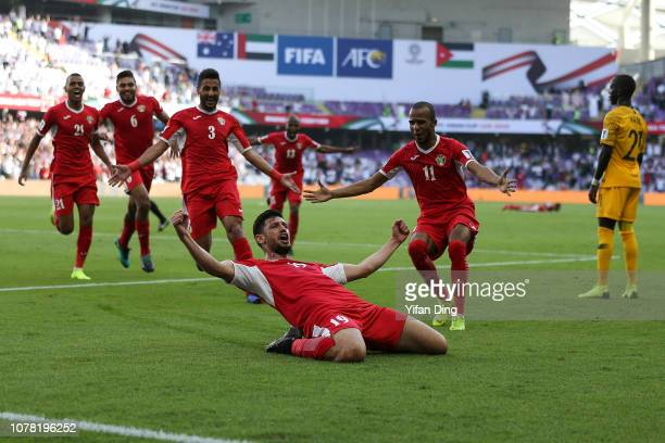 Anas BaniYaseen of Jordan celebrates scoring the opening goal during the AFC Asian Cup Group B match between Australia and Jordan at Hazza Bin Zayed...