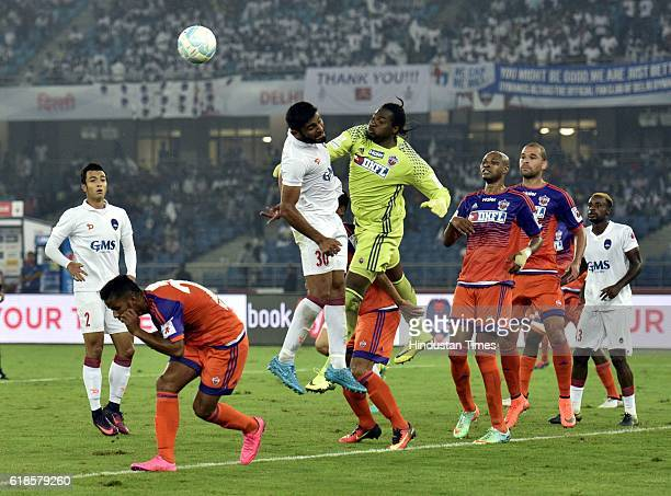 Anas Edathodika of Delhi Dynamos FC and FC Pune City goalkeeper Apoula Edima in action during the India Super League football match on October 27...