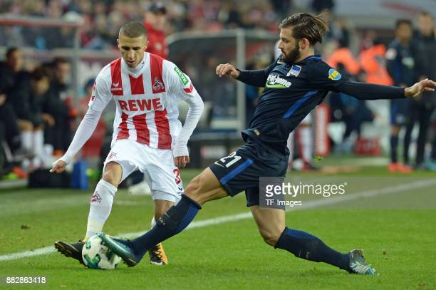 Anas Ouahim of Koeln and Marvin Plattenhardt of Hertha BSC Berlin battle for the ball during the Bundesliga match between 1 FC Koeln and Hertha BSC...