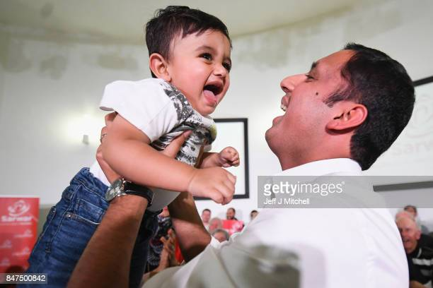 Anas Sarwar is seen on stage with his family at the launch of his campaign to be Scottish Labour leader at the Gorbals Parish Church on September 15...