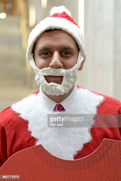 Anas Sarwar MSP dons a Christmas jumper in support of a Save The Children charity event after First Minister's Questions in the Scottish Parliament...