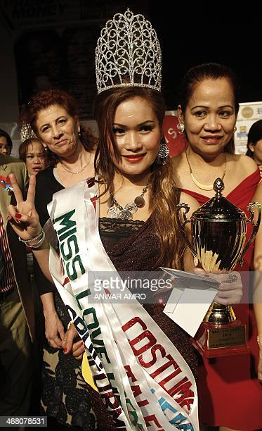 Anasah Arpon gestures after winning the first prize in the Miss Philippino Domestic Worker beauty pageant held in Babel theatre in the Lebanese...
