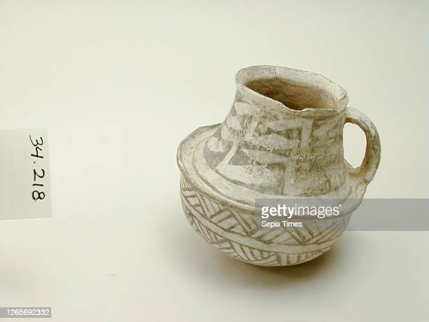 Anasazi, Native American, Pitcher with Handle, between 900 and 1100, grey ware, white slip, black paint, Overall: 6— 7— 6 1/4 inches .