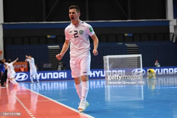 Anaskhon Rakhmatov of Uzbekistan celebrates scoring a goal during the FIFA Futsal World Cup 2021 group B match between Egypt and Uzbekistan at...