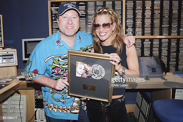 Anastacia and Dr Fox in a studio at Capital Radio Anastacia is holding an award received for her album 'Not That Kind' London 2001