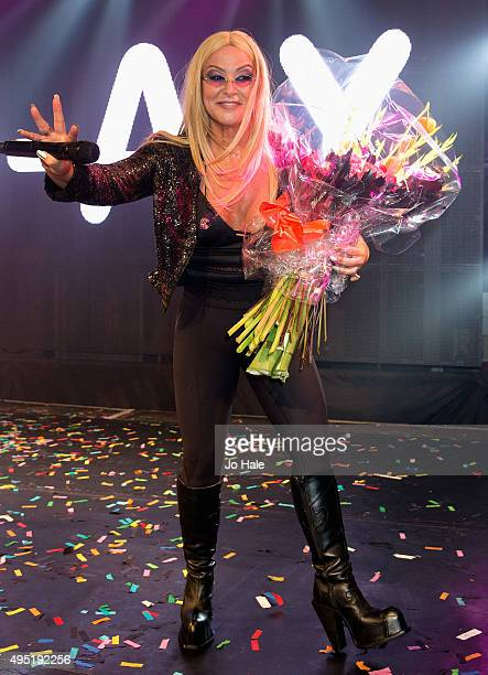 Anastacia receives flowers on stage at GAY Heaven in London on October 31 2015 in London England