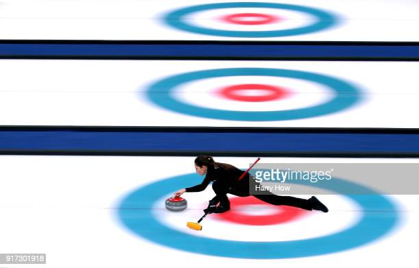 Anastaia Bryzgalova of Olympic Athete from Russia throws a rock in a 75 loss to Switzerland during the Curling Mixed Doubles SemiFinals Session One...