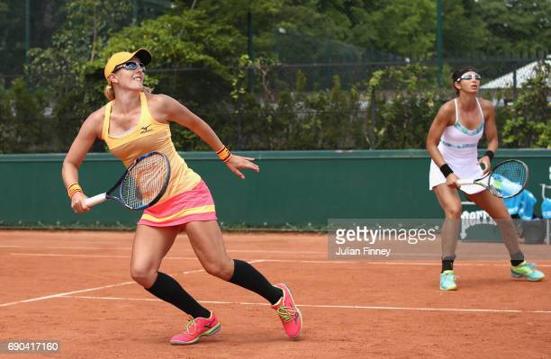 Anastaisa Rodionova of Australia watches the flight of the ball with partner Darija Jurak of Croatia in the ladies doubles first round match against...