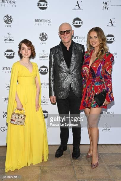 Anastasia Antropov,John Caudwell and Modesta Vzesniauskaite attend the Amber Lounge 2021 Fashion Show on May 21, 2021 in Monte-Carlo, Monaco.