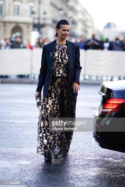 Anastasia Barbieri wears a blazer jacket a golden and purple sequin shiny mesh dress outside the Opera Garnier 350th Anniversary Gala in Paris on May...