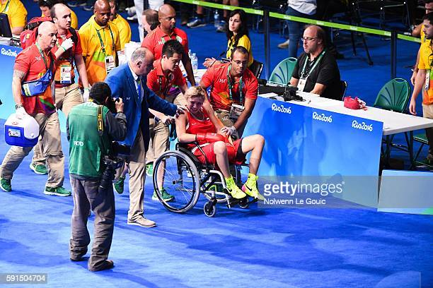 Anastasia Belyakova of Russia leave the ring injured in the womens lightweight 5760kg during the Boxing at Riocentro on August 17 2016 in Rio de...