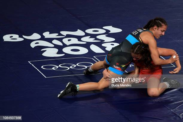 Anastasia Blayvas of Germany fights with Irina Ringaci of Moldova in Women's Freestyle 57kg Bronze Medal Match during day 7 of Buenos Aires Youth...