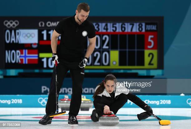 Anastasia Bryzgalova and Aleksandr Krushelnitckii of Olympic Athletes from Russia deliver a stone against Norway during the Curling Mixed Doubles...