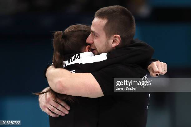 Anastasia Bryzgalova and Aleksandr Krushelnitckii of Olympic Athletes from Russia celebrate after defeating Norway to win the bronzel medal during...
