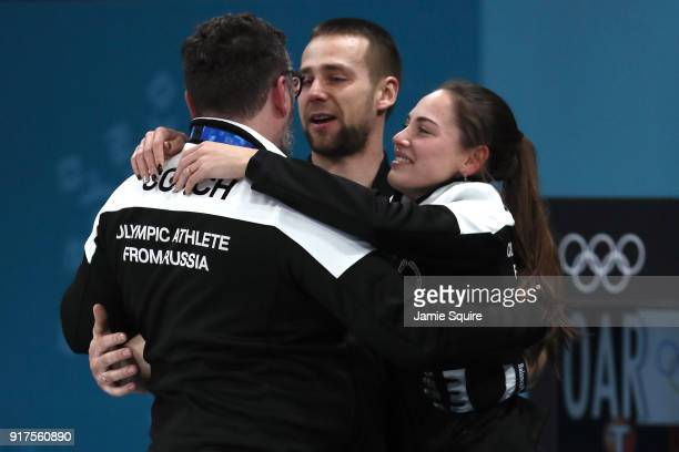Anastasia Bryzgalova and Aleksandr Krushelnitckii of Olympic Athletes from Russia celebrate with coach Vasily Gudin after defeating Norway to win the...