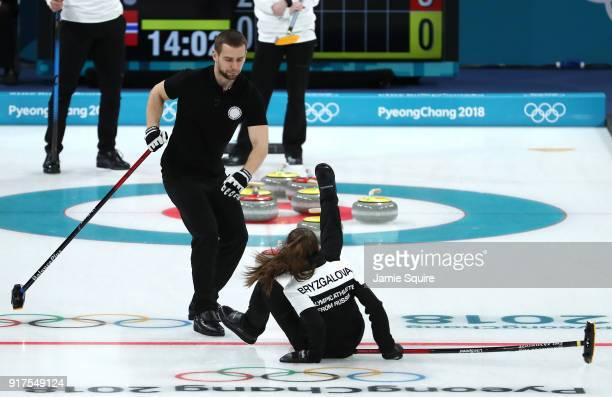 Anastasia Bryzgalova of Olympic Athletes from Russia falls as she competes against Norway during the Curling Mixed Doubles Bronze Medal Game on day...