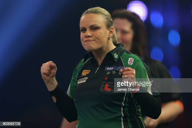 Anastasia Dobromyslova of Russia celebrates against Anca Zijlstra during the First Round of the BDO World Darts Championship at Lakeside Country Club...
