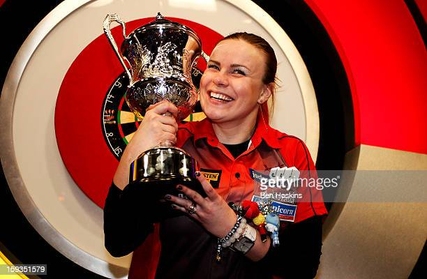 Anastasia Dobromyslova of Russia celebrates with the trophy after winning the women's final during the women's final on day eight of the BDO Lakeside...
