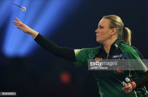 Anastasia Dobromyslova of Russia in action against Anca Zijlstra during the First Round of the BDO World Darts Championship at Lakeside Country Club...