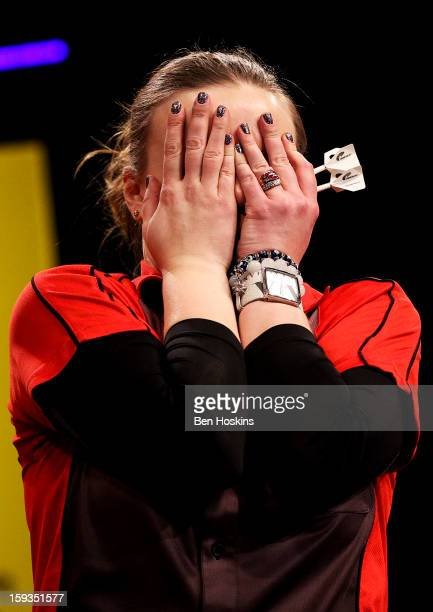 Anastasia Dobromyslova of Russia reacts after winning the women's final on day eight of the BDO Lakeside World Professional Darts Championships at...