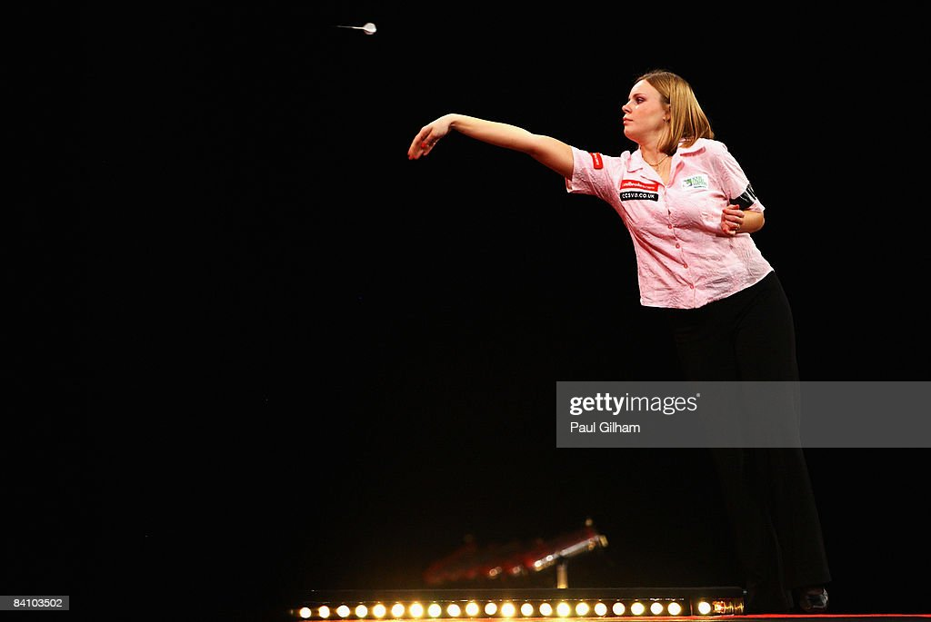Anastasia Dobromyslova throws a dart during the first round match between Remco van Eijden of Netherlands and Anastasia Dobromyslova of Russia during the 2009 Ladbrokes.com PDC World Darts Championship at Alexandra Palace on December 21, 2008 in London, England.