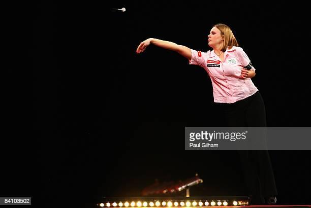Anastasia Dobromyslova throws a dart during the first round match between Remco van Eijden of Netherlands and Anastasia Dobromyslova of Russia during...