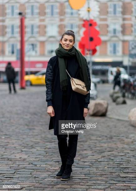 Anastasia Graversen wearing an olive scarf beige Chanel bag black jacket ankle boots during the Copenhagen Fashion Week Autumn/Winter 17 on February...