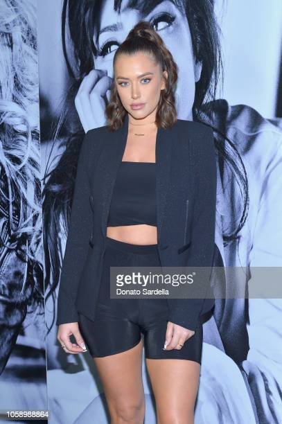 Anastasia Karanikolaou wearing Marciano blazer attends the GUESS Holiday 2018 Event on November 7 2018 in West Hollywood California