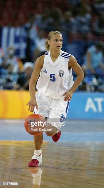 Anastasia Kostaki of Greece advances the ball in the women's basketball preliminary game against Russia on August 14 2004 during the Athens 2004...