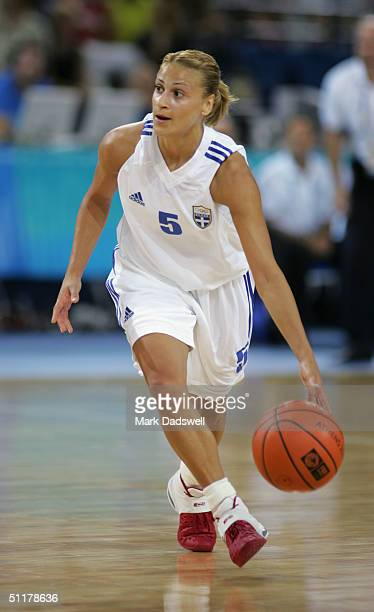 Anastasia Kostaki of Greece dribbles the ball in the women's basketball preliminary game against Russia on August 14 2004 during the Athens 2004...