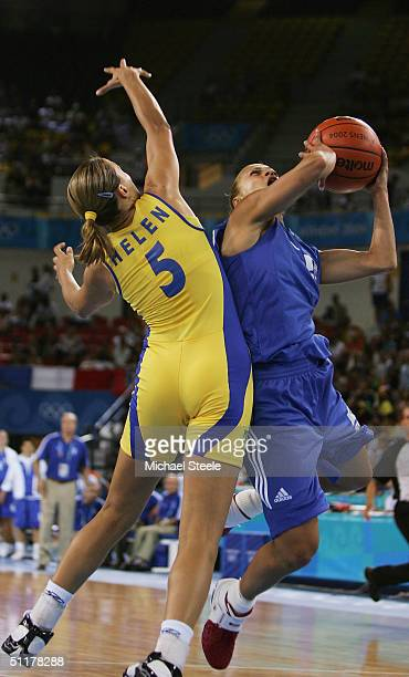 Anastasia Kostaki of Greece goes to the basket against Helen Cristina Luz of Brazil in the women's basketball preliminary game on August 16 2004...
