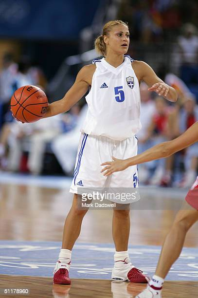 Anastasia Kostaki of Greece looks to move the ball in the women's basketball preliminary game against Russia on August 14 2004 during the Athens 2004...