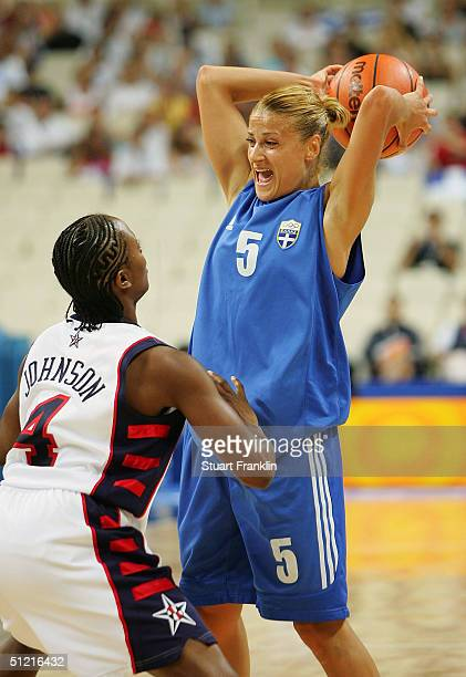 Anastasia Kostaki of Greece looks to pass over Shannon Johnson of USA during the women's basketball quarterfinal game on August 25 2004 during the...
