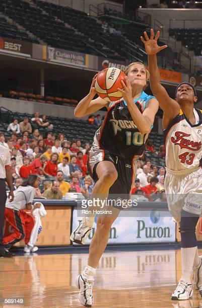 Anastasia Kostaki of the Cleveland Rockers drives to the basket past Alicia Thompson of the Indiana Fever during a preseason game at Conseco...