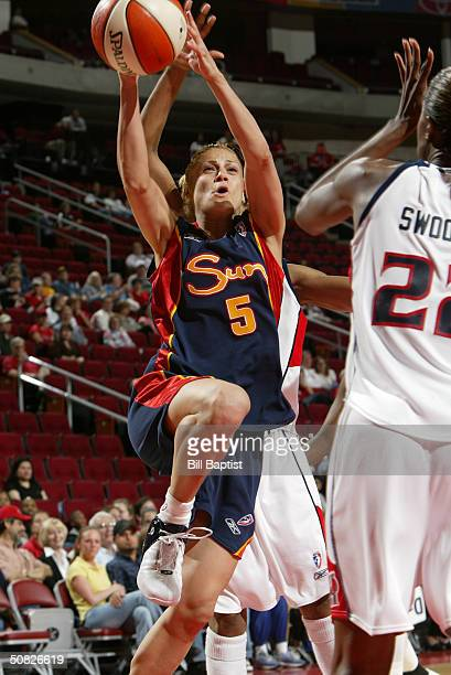 Anastasia Kostaki of the Connecticut Sun shoots over Sheryl Swoopes of the Houston Comets on May 11 2004 at the Toyota Center in Houston Texas NOTE...